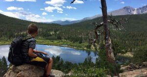 kids taking in the view of a mountain lake