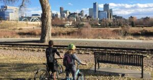the denver skyline from the cherry creek trail