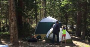 setting up the tents at a campground