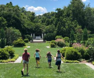 kids running through the gardens at the Reynolda House, things to do in Winston-Salem