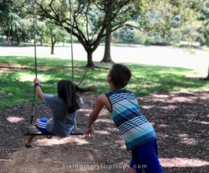 kids playing on swings on wake forest university campus