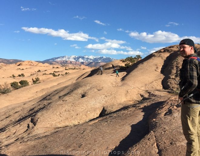 views of the la sal mountains from the slickrock trail in moab ut