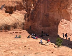 lunch under the shade of corona arch in moab UT