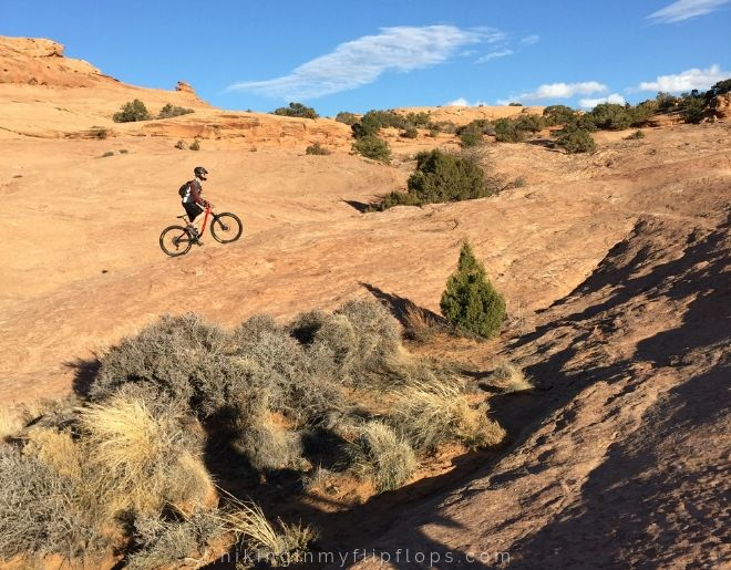 mountain bikers on the Slickrock Trail is also on of the best Moab hiking trails