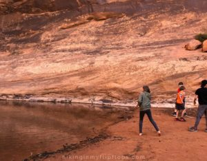 skipping rocks from the pool at the base of middleearth waterfall in moab ut