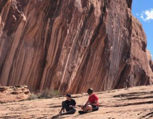 the boys taking a break on the hike to middleearth waterfall in moab ut