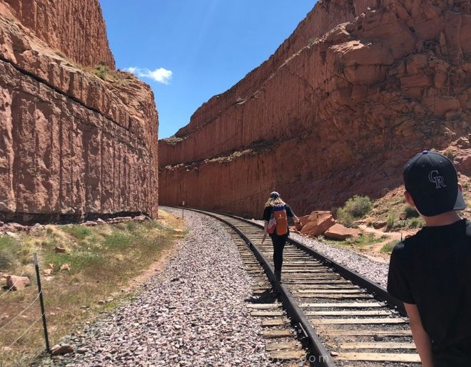 crossing train tracks on the corona arch trail in Moab UT