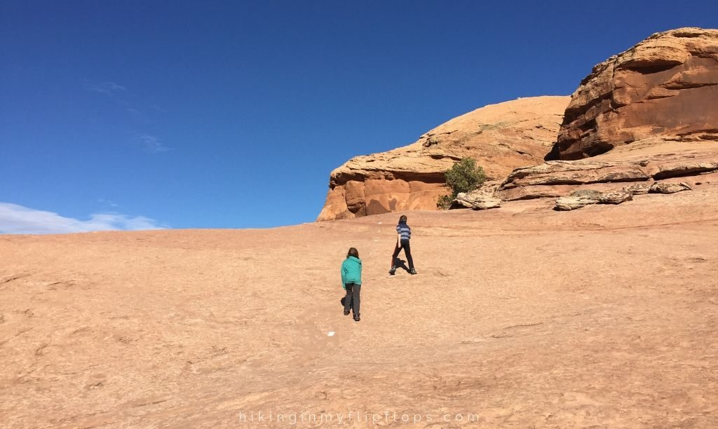 following the painted lines on the Slickrock Trail in one of many favorite Moab hiking trails (Moab UT)