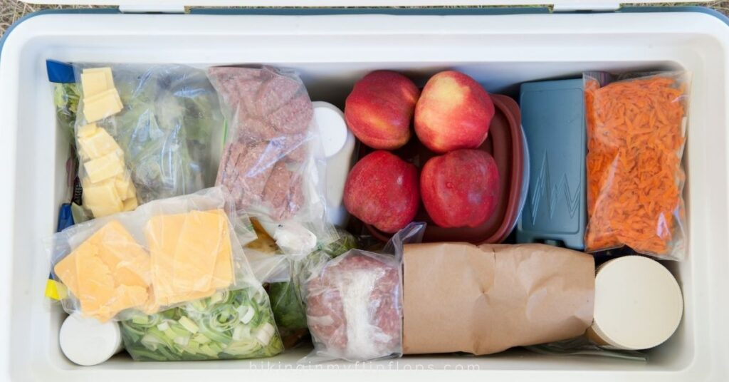 cooler filled with food for camping
