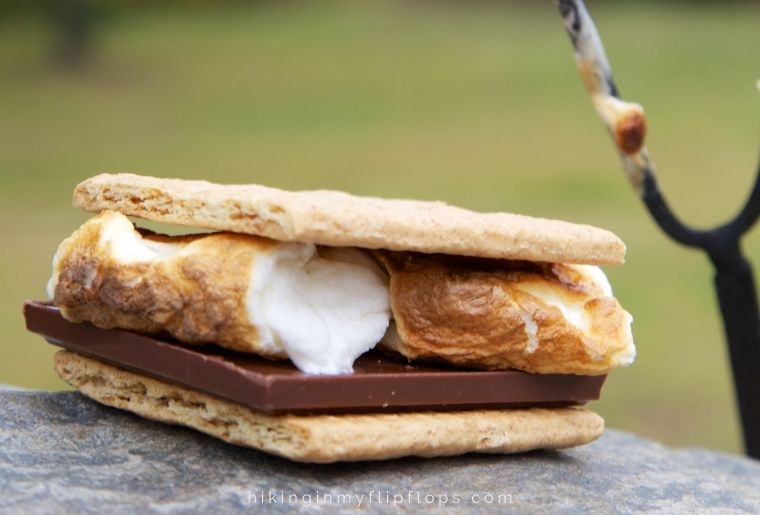 a s'more - making this campfire dessert of one of the most popular camping activities at night