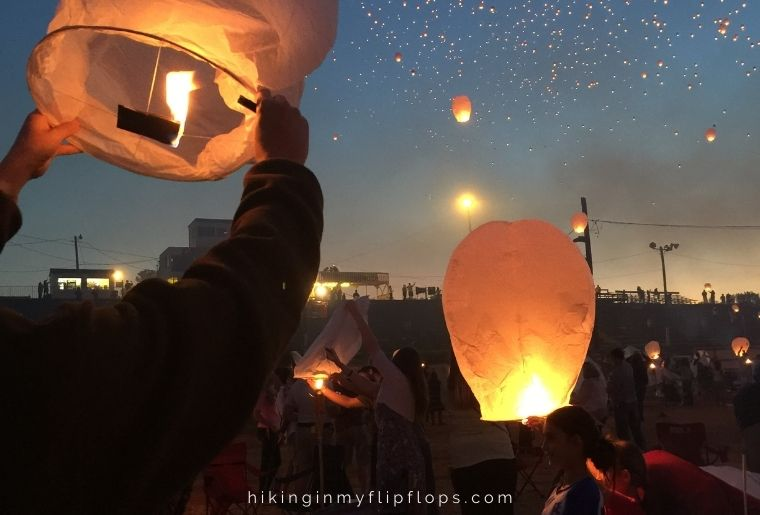releasing paper lanterns is one of the fun things to do while camping at night