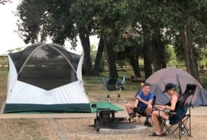 two camping tents: one for adults and one for the kids