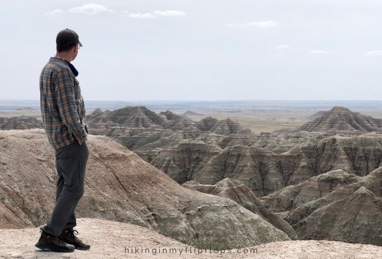 view from an overlook at badlands national park on a south dakota road trip