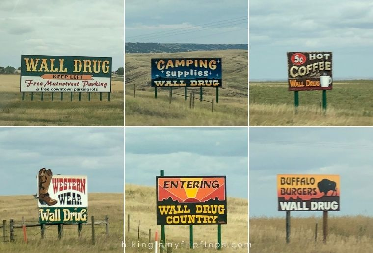 signs for wall drug along the highway in south dakota