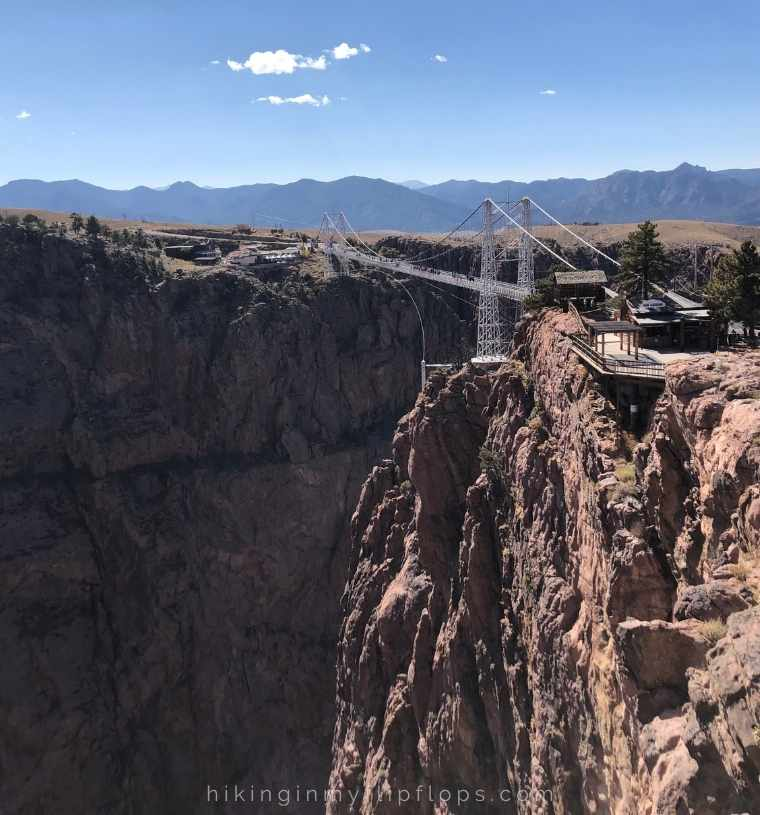 a view of the Royal Gorge Bridge; walking across the bridge over the gorge is one of the top things to do in canon city, Colorado
