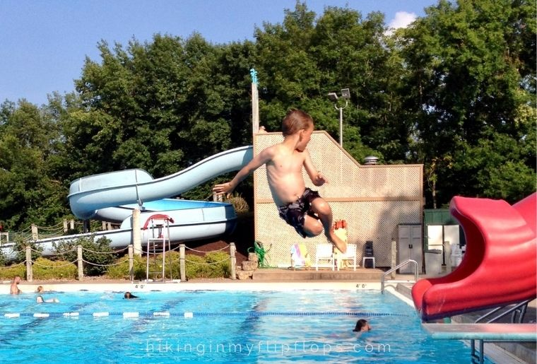 playing on the slide at the community pool for outdoor activities for families