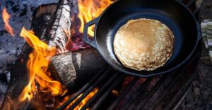 camping pancakes cooked over the campfire
