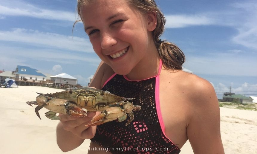 holding a crab caught on Dauphin Island