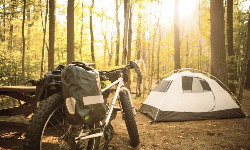 camping gear stored on a bike in a type of camping called bikepacking