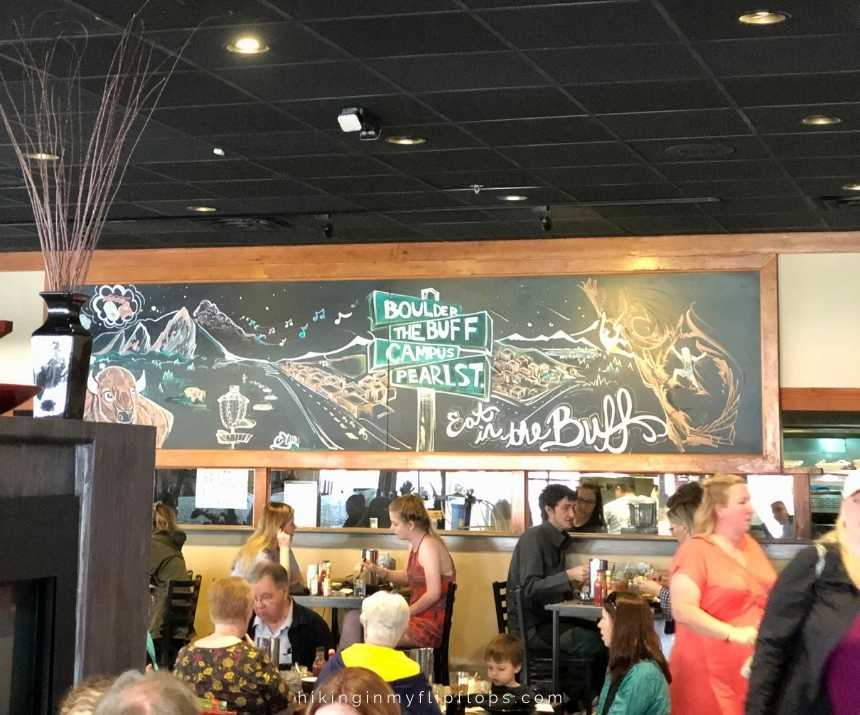 people having brunch at the Buff restaurant in Boulder colorado is a must do on any boulder itinerary