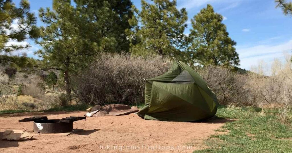 a camping tent blown over in the wind, one of the more common camping mistakes is not being prepared to improvise