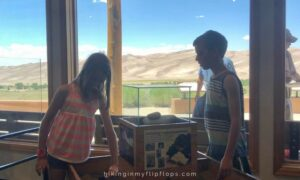 kids at the visitor center, filled with things to do at Great Sand Dunes National Park in Colorado