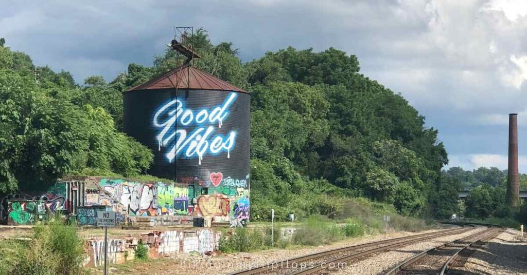 """asheville's water tower mural in the river arts district with a """"good vibes"""" message"""
