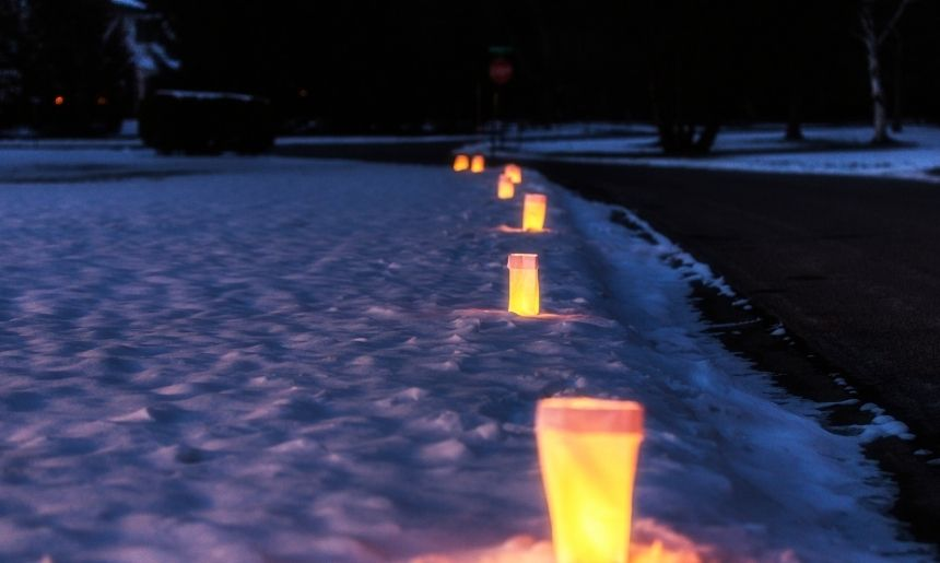 luminaries line a pathway, which are one of the easy and effective campsite lighting ideas