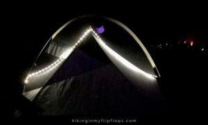 rope lights outline a tent, one of the more effective camping tent lighting ideas
